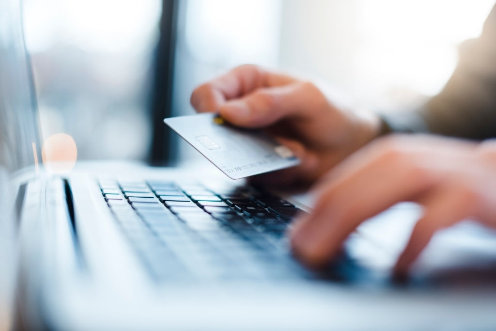 typing the credit card number using a laptop